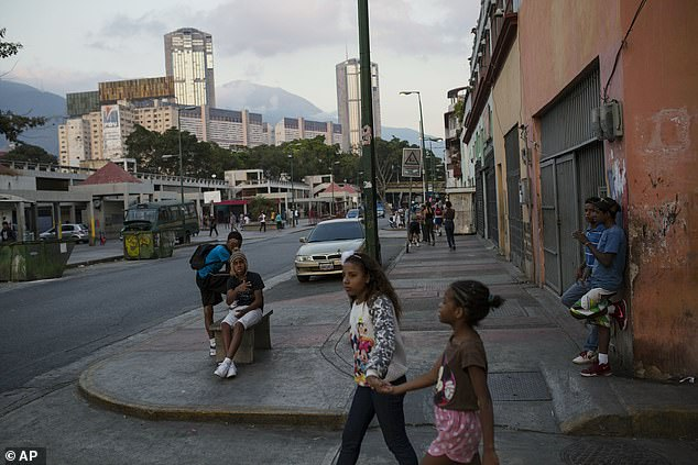 Teenagers gather in San Agustin neighborhood in Caracas